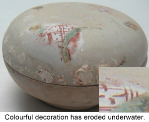 Painted overglaze decoration on this Chinese Porcelain shows severe wear after centuries underwater.